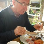 Father in law enjoying superb cooked breakfast.
