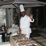Chef cooking up the Barbeque at the Villa