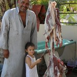 Our host, his son, the sacrificial Eid goat