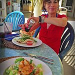 Sally Herschorn enjoys lunch on the oceanside deck at Cobalt Coast Resort