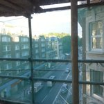 Looking out of the room, through the scaffolding, onto the main road, below.