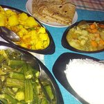 vegan food: okra, aloo gobi, spicy vegetables, chapati