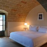 Bedroom of our suite, with its beautiful stonework