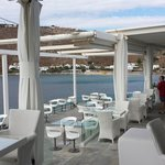 experience eating on a terrace floating above the blue Aegean