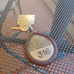 Unique room key with brass medallian