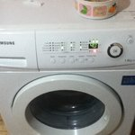 Yes, there is a washing machine (and detergent)  :)