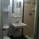 Very well maintained bathroom.  New shower head, clean tile.