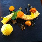 Cheese cake of muscat pumpkin with candied kumquat and pumpkin seed oil ice cream