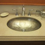 hammered silver sink? surely not, but very attractive