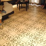The floor tiles was the first thing that captured one's attention once the door was opened into