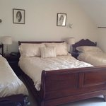 large room with a queen and 2 twin beds!