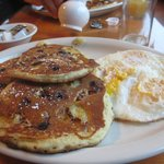 Blueberry, walnut and banana pancakes and eggs