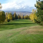 The adjoining golf course in dazzling autumn colours