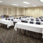 The 1/2 meeting room can be set for 30 people.