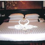 Honeymoon Bed with swans and fresh flowers