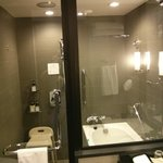 Bathroom with handheld shower head, rainshower obove, and bathtub