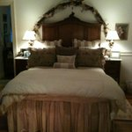 Comfortable and cozy queen bed in the Songbird suite ...