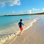 our oldest son running on the immaculate beach at sunset