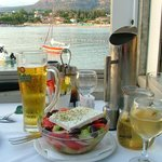 Our Greek Salad with view of Stoupa in the background