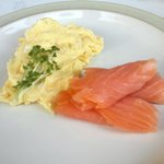 Delicious scrambled egg & smoked salmon served with toast and butter and fresh ground coffee