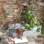 Small shrine near garden wall