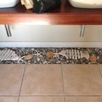 A lovely design touch - the floor under the wash hand basins.