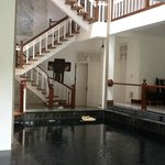 Pool and staircase to upper floors. 'In and out' pool.