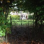 view through the back garden gate, looking toward the house