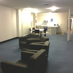 Level 4 open common room with tv, kitchen and table&chairs