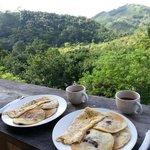 Breakfast looking over a jungle.