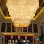 The crystal chandelier in the hotel lobby