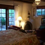 Large, well furnished bedroom with kiva