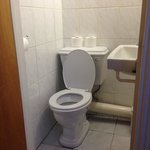 the toilet so close to ghe wall it was hard to sit down correctly.