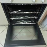 Oven with racks lined with aluminium foil