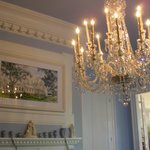 Chandelier, molding, painting in dining room
