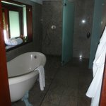 The spacious bathroom with tub & rain shower.