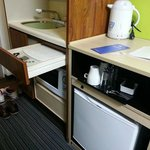 small room but theres electrical stove, fridge, kettle and even a microwave!
