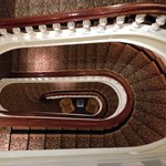 View from above of the huge sweeping oval staircase