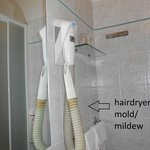 Bathroom conditions - Outdated dirty  hairdryer