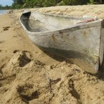 Wooden boat carved by Belizean boat builder and in use at Sabal Beach.