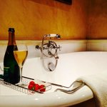 Bathtub, champagne, strawberries