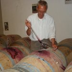 Sampling wine right from barrel.