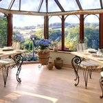 Dining conservatory overlooking garden & valley