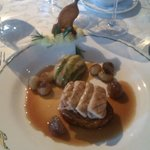 Grilled tender rabbit fillets, served on a celeriac fondant, glazed chestnuts and armagnac sauce