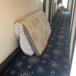 Matress on landing outside room - fire escape