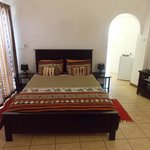 room 4, ground floor with a queen size bed bathtub and shower, bar fridge, dstv, dressing area!!