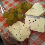 Cheese with cranberries, cheese with dill, cheese with cumin and grapes