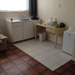 the kitchenette. very old furniture and the white tiles they put there was uneven and my friend