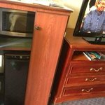Microwave and fridge and flat screen tv
