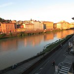 Arno River, street and tiny corner of Ponte Vecchio in distance, as seen from room window.